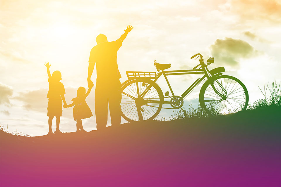 family with bike in the sunlight